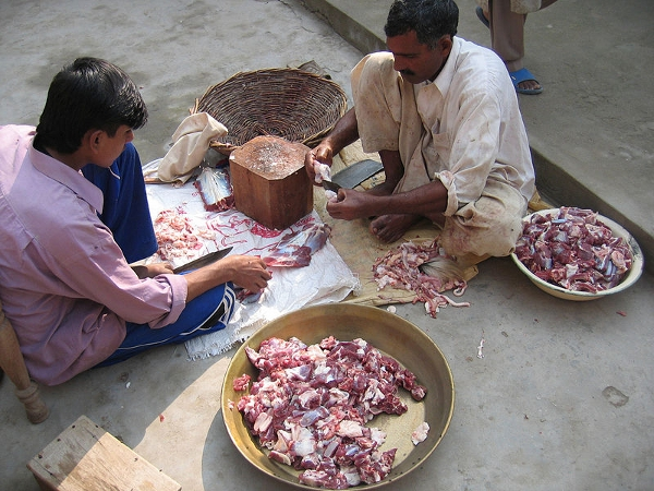 Ritual celebrants divide up meat for the feast