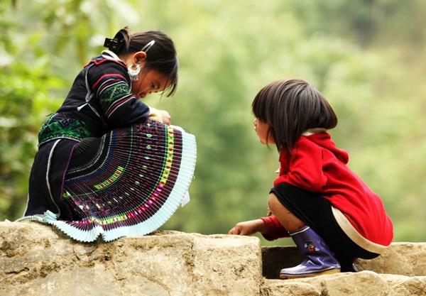 Aborigine children play at a village in Sapa, Northern Vietnam