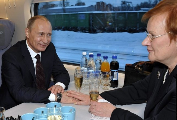 Russian Prime Minister Putin and Finnish President Tarja Halonen chat aboard Allegro