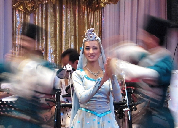 Dancers in traditional Azeri costumes at a wedding in Baku