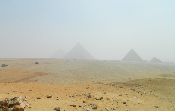 A sand storm brews over the pyramids