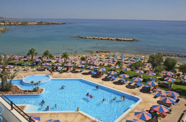 The pool and beach at Magnuson's Corallia Beach Hotel
