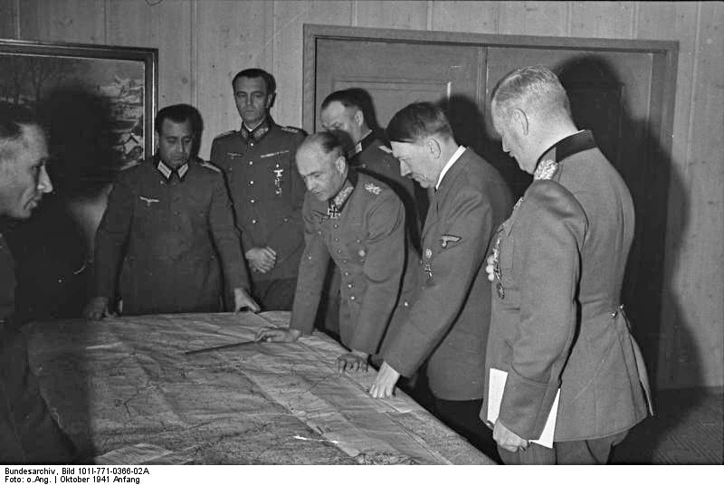 Hitler and his generals discuss military operations at the Wolf's Lair. Image courtesy German Federal Archives
