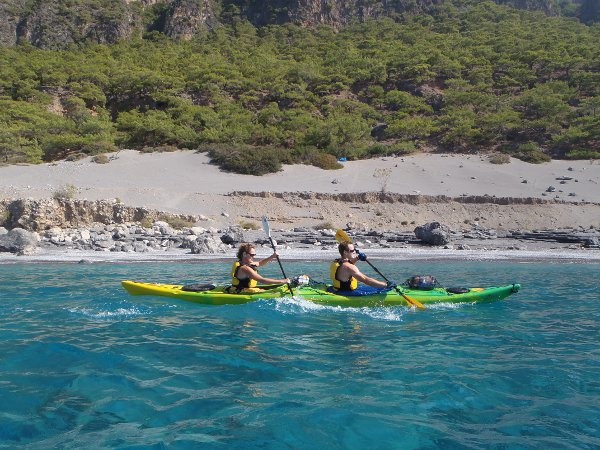 A couple kayaking in Crete