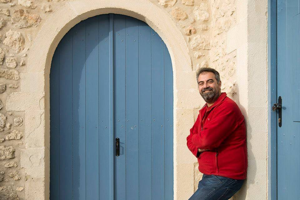 The now iconic photo of Evan outside the villa with big, blue, doors - click to vote