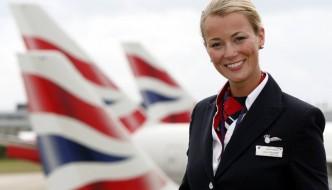 A BA cabin crew member welcomes fliers