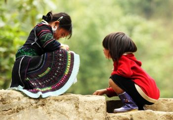 Aborigine children play at a village in Sapa, Northern Vietnam