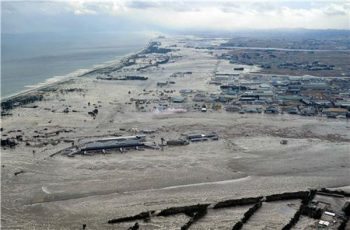 A view of the flooded Sendai Airport and coast after the tsunami. REUTERS/Kyodo