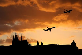 Planes departing Prague at sunset.