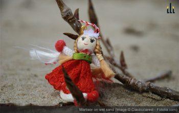 martisor puppett on the wet sand