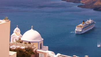 A cruise ship puts in at Santorini