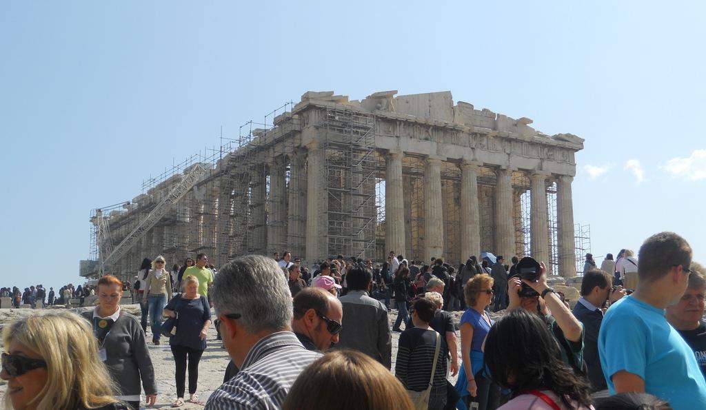Tourist flock to the Parthenon in Athens - Erik Drost