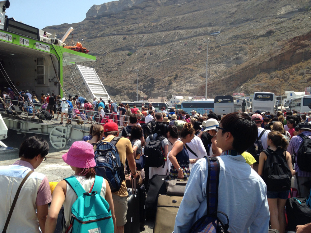 A throng of tourists leaving Santorini in 2014