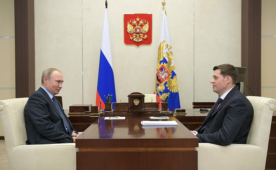 Russian President Vladimir Putin in a 2018 meeting with With Severstal CEO Alexei Mordashov