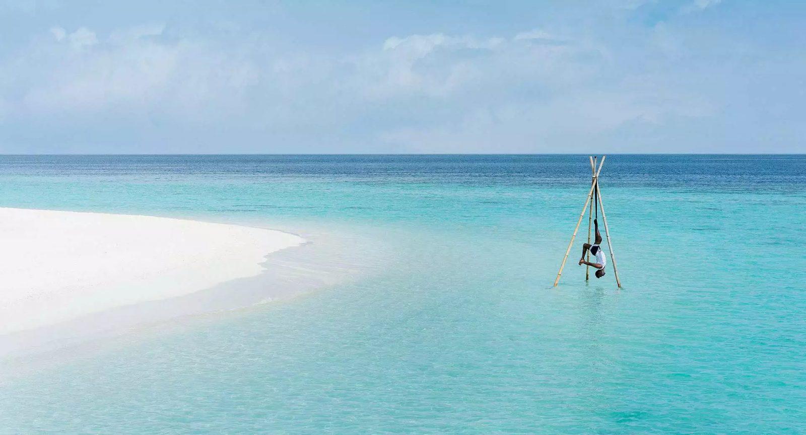 Overwater Yoga at Anantara Kihavah Maldives Villas
